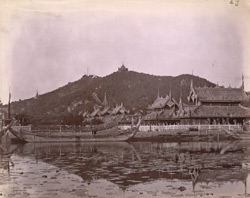 View of the moat north of the city, looking towards Buddhist monastery buildings and the hills beyond, Mandalay